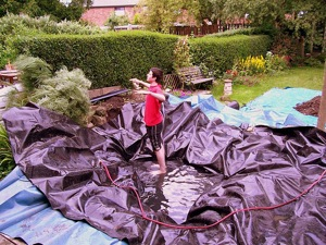 filling pond How to Build a Pond  a Step by Step Guide